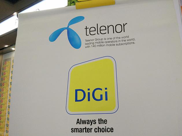 DiGi Telecommunicationsの販売店にはTelenorグループであることを示す掲示物も見られた。