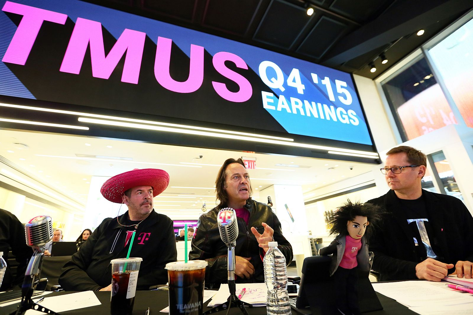 From left to right, T-Mobile CFO Braxton Carter, CEO John Legere and COO Mike Sievert report record customer numbers, higher revenue and a growing network during quarterly earnings from a new signature store in New York's Times Square, Wednesday, February 17, 2016. In Q4 the company reported 2.1 million total net customer additions, marking the 11th quarter in a row with more than 1 million additions.(Stuart Ramson/AP Images for T-Mobile)