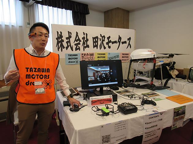 田沢湖モーターズの展示コーナー。地元でも東光鉄工のドローンや、ウェアラブルカメラなどを販売している。