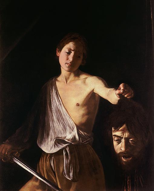 図6──暗闇の一部に光が当てられたようなカラヴァッジョ〈ゴリアテの首を持つダビデ〉1609-10。(「ミケランジェロ・メリージ・ダ・カラヴァッジョ」wikipedia)