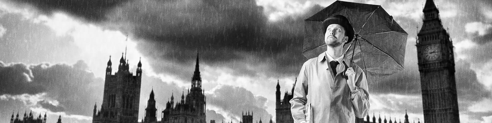 イギリス 雨 男性 イメージ